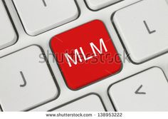 Red MLM (Multi Level Marketing) button on keyboard close-up