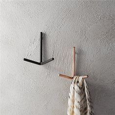 Shop print hooks.   3-sided iron prong angles a space-saving spot for coats, keys, jewelry, scarves and hats in the entry, kitchen or bedroom.  Designed to de-clutter small spaces, handcrafted hook finishes sleek with a copper or black coating.