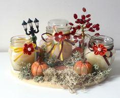 candele autunnali con zucche