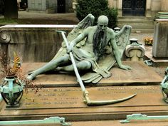 Angel of Death rests in the Monumental Cemetery in Milan, Italy.