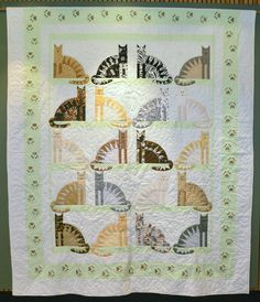 Sawtooth Cats quilt by Marcia Lee Hartnell.  2013 Fine Art of Fiber exhibit. A lovely version of the pattern by The City Stitcher.