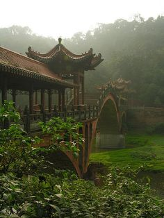 Bridge in the mist, Leshan, China. Leshan is a prefecture-level city located at the confluence of the Dadu and Min rivers in Sichuan Province. Places To Travel, Places To See, Travel Destinations, Holiday Destinations, Places Around The World, Around The Worlds, Beautiful World, Beautiful Places, Vietnam