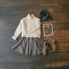 Cropped high neck jumper & check flair midi skirt: www.oliveclothing.com