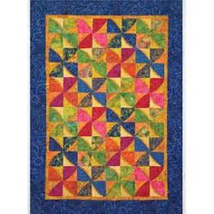 Motion Commotion Quilt 1 layer cake or 2 charm packs (46x64 or 68x84).  Really cute;  think it's mainly the fabrics!