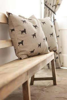 00177b02ae8 Two striped Emily Bond cushions with dogs on them on a bench with a  matching curtain in the background