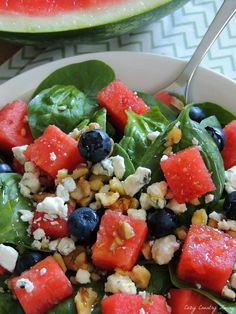Spinach & Watermelon SaladFresh Organic Baby Spinach Freshly chopped Watermelon Feta or Bleu Cheese Crumbles, which ever you prefer Roughly chopped Walnuts Fresh Blueberries pinch of salt Grilled Chicken (optional) Olive Oil, your favorite Bleu Cheese Dressing or Vinaigrette