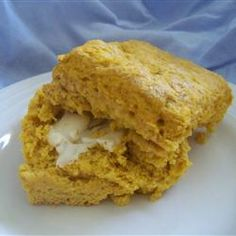Pumpkin Scones Allrecipes.com   Add in cinnamon bits for more flavor...      Preheat oven to 400 degrees F (200 degrees C).     In a mixing bowl, beat together butter, sugar, eggs and pumpkin. Stir in flour, cinnamon, nutmeg and salt by hand.     Roll out into 1/2 inch thickness and cut into rounds. Place on tray close together and bake for 15 to 18 minutes.