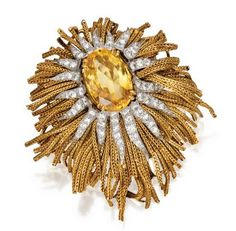 18 KARAT GOLD, PLATINUM, YELLOW SAPPHIRE AND DIAMOND BROOCH, STERLÉ, PARIS, CIRCA 1960