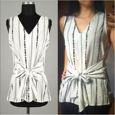 ❗️2 Left - White Sheer Geometric Print Blouse Made in USA- this new style is a super chic slightly sheer woven tank blouse with vneck line in abstract geometric stripes featuring a stunning tie waist that can be tied in the front with a bow or in the back with a bow. Made of 100% viscose. Fits TTS. You may purchase this listing as I've created individual listings for each size. Price is firm. S(2-4) M(6-8) L- SOLD OUT! ValMarie Boutique Tops Blouses