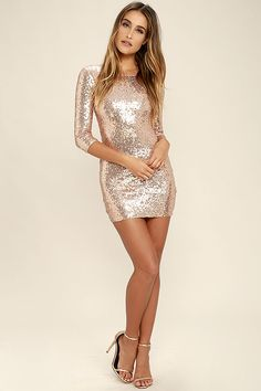 Let them know you're a fashion boss in the World's a Stage Rose Gold Sequin Dress! This woven poly dress is covered with beautiful shining rose gold sequins, for a stunning look. The rounded neckline has a scooping back and three-quarter sleeves, with a darted, fitted bodice and bodycon skirt. Hidden back zipper.