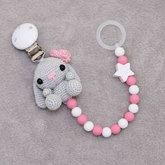 """61 Likes, 7 Comments - Tanja Greiff crochet studio (@madebytanya) on Instagram: """"Napphållare med en virkad, liten kaninflicka och silikonpärlor. #napphållare #amigurumi #virkad…"""""""