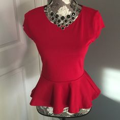 Gorgeous red top Is this not the cutest top ever? It's a bit tight on me.  Like new condition.  Comfy jersey material.  It says medium but it's on the smaller side of medium. Ambiance Apparel Tops