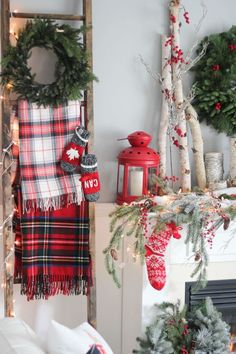 Spruce up a mantle with a plaid, cozy blanket and red stockings. See more at Craftberry Bush.