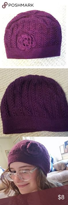 NWOT Beautiful Handmade Purple Beanie Bought this in Peru, never worn. Made from alpaca fur, so it it super soft and warm. The flower detail is sweet and adds some warmth in the cold! Accessories Hats