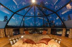 Kakslauttanen in Finnish Lapland, Finland At Kakslauttanen you can stay in a snow igloo, a log cabin, or the coolest thing ever...a glass igloo! Lie in your bed and watch the Northern Lights for a one-of-a-kind vacation.