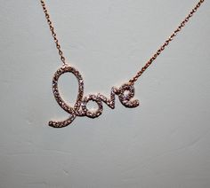 Love Necklace Rose Gold with CZ's, Love Necklace - Simple - Elegant. $47.50, via Etsy.