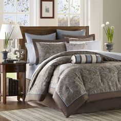 This chic comforter set showcases an eye-catching paisley motif in blue and taupe, while soft cotton sheets offer restful comfort.    Pr...