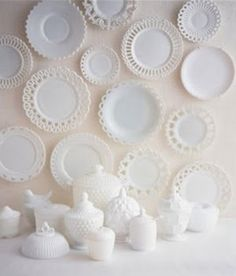 milk glass! - call me crazy but I like the plates on the wall... maybe not as many and put in a grouping with something more modern - would be super cute!