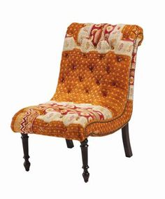 Create a striking accent and add a splash of color to any décor with our Kantha Warm Chair.