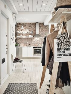 Hallway with wooden clothes rack