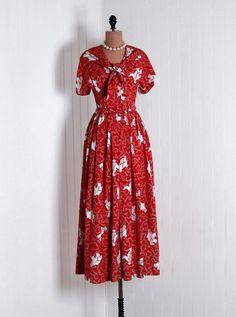 "Party Dress, Lyn Delle: 1940's, American, nautical ""Sailor-Boy Honey-Bun"" novelty silk/rayon print, portrait collar sculpted tie bodice, matching belt, swing skirt."