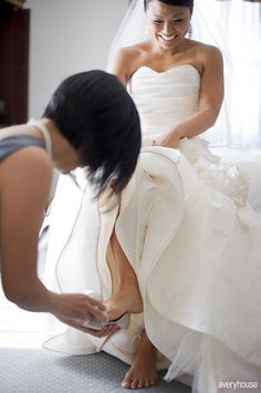 Putting on her wedding shoes!
