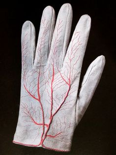 These gloves are an objet d'artiste by Meret Oppenheim, a limited edition sold with the magazine Parkett in the eighties.