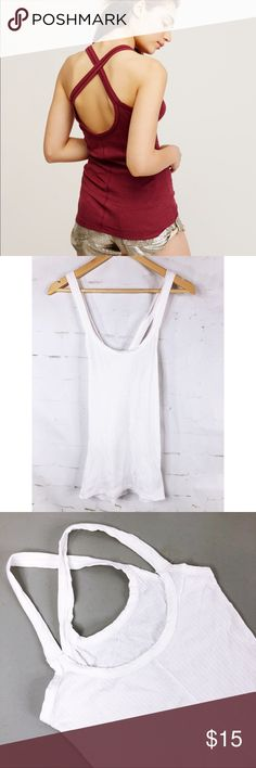 "Free People Intimately Woman's White Tank Straps crisscross in the back.  This is for a white ribbed tank modeled picture is to show fit. Bust 16"" Length 22"" Free People Tops Tank Tops"