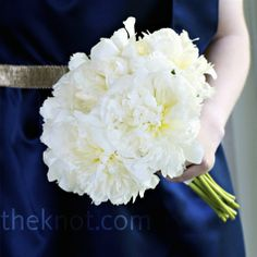 Similar but more of an ivory color; would look nice against the fuschia dresses - bridesmaid bouquets