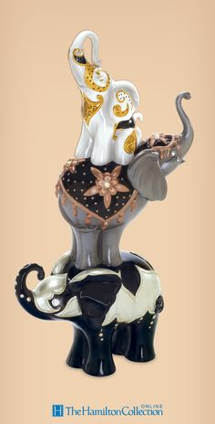 Bring your elephant appreciation to towering new heights with Blake Jensen's decadent Lucky Me Elephants Figurine!