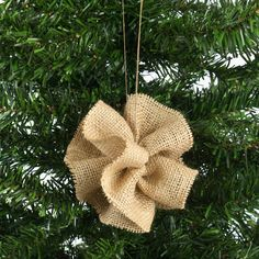 Features:  -Material: Sanitizied burlap.  -Color: Tan.  -Hanger.  -Made in the USA.  Country of Manufacture: -United States.  Product Type: -Shaped ornament.  Color: -Tan.  Number in Set: -6 or more.