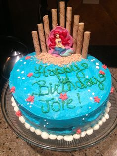 "Pinner Wrote: Joie's 6th birthday cake- the Little mermaid sits atop an almond sour cream cake with buttercream frosting (made with butter and coconut oil as well). Graham cracker sand, yogurt raisin pearls and we used Swedish fish to make an impression and ""suggest"" the idea of fish swimming under the sea"