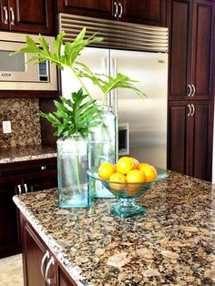 Kitchen Countertops: Colors and Materials from HGTV love the granite, dark cabinets and light tile floors!