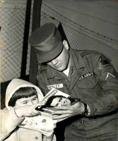 Elvis in the army in Germany in 1959 with fans.