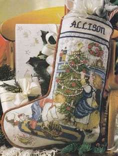 Cross Stitch Trimming The Tree Christmas Stocking Pattern Cross Stitch Christmas Stockings, Cross Stitch Stocking, Christmas Stocking Pattern, Xmas Stockings, Christmas Patterns, Cross Stitching, Cross Stitch Embroidery, Cross Stitch Patterns, Needlepoint Stockings