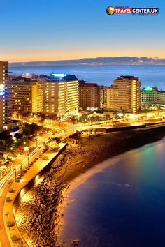 Puerto de la Cruz hotel zone lights up at the fall of dusk giving an astounding nightfall view. The Canary Islands in Spain always have something distinctive in them. #Tenerife #Spain #Canary #Europe #Sunset #travel #Pinterest #ItsAllAboutTravel #TravelCenterUK
