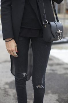 Slight variation on grey/black shades, minimalist, varied hemlines on shirt/jacket/layered overlay, minimalist silver rings and red nails