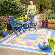 Try your hand at a fun paint technique and update concrete with a faux floorcloth. Using a stencil and paint, you can create a fun, personalized focal point in your backyard without much time or money. Tape off blocks of color with painter's tape and stencil your design with acrylic paint. Protect your outdoor rug with clear satin concrete sealer.