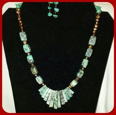 SALE  Stunning African Turquoise Necklace Set African turquoise necklace and earring set.  Stunning looking piece.  Necklace is 19 inches long plus has a 1-1/2 inch extender.  Earrings are 1-1/4 inches long from the top of the fish hook ear wire.  Set is new and handmade by me. Handcrafted Jewelry Necklaces