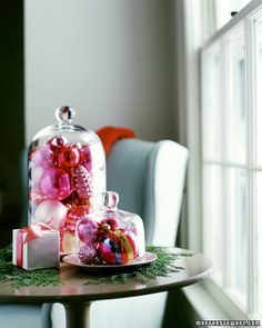 Christmas Cloche... could also use glass cake cover.  Fill with ornaments to use as centerpiece.  I do this for every occasion.  I have a rabbit and Easter basket under cloches now for my Easter table display!