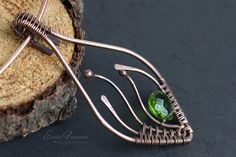 copper wire wrapped pendant with light green faceted crystal drop1