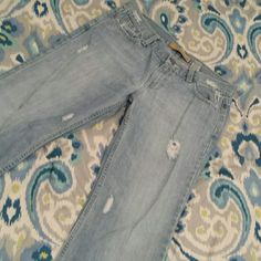 Ladies distresed jeans Light denim distressed blue, boy cut jeans. Never worn. Old Navy Jeans Boot Cut