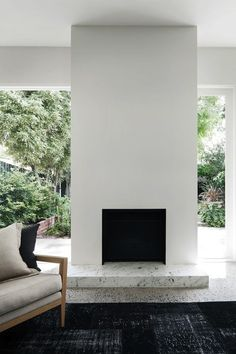 Bianco Giao stone at foot of fireplace Georgina Jeffries and Pip McCully in Prahran, Victoria, Remodelista