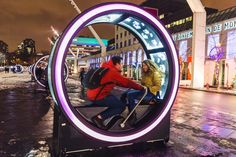 Giant Illuminated Wheels- http://www.homecrux.com/2016/12/10/58271/luminous-wheels-light-up-place-des-festivals-2016-2017-in-montreal.html- Montreal uses human powered video screens to create engaging public spaces.