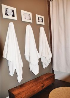 Pictures above towels and hooks vs. a bar to hang them on