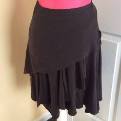 Free People black skirt Cutest ever!!  Free People black pull on skirt with asymmetrical layers and hem. Gorgeous with tights and boots, flats or heels for so many great looks! Free People Skirts
