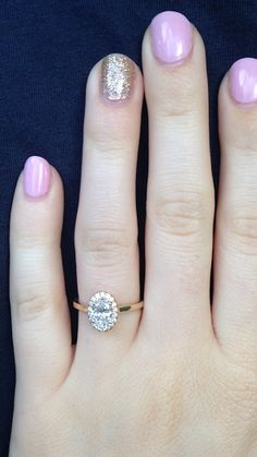 My beautiful engagement ring! Solitare yellow gold ring with oval diamond and halo. He worked so hard for this and I think it's just the most beautiful thing I've ever seen!
