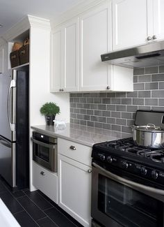 White Kitchen Shaker Cabinets smoke gray glass subway tile, white shaker cabinets, pull down