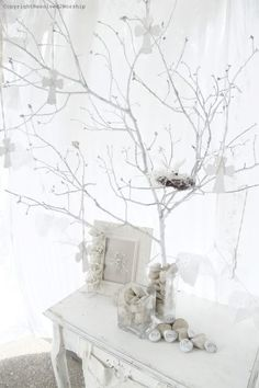 Love this!! White branches for Christmas or Easter
