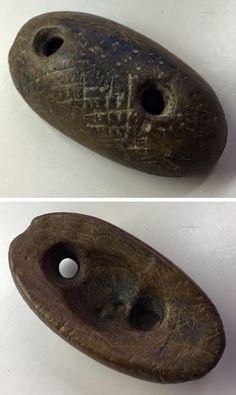 Native American artifacts, engraved loaf stone, North Carolina.